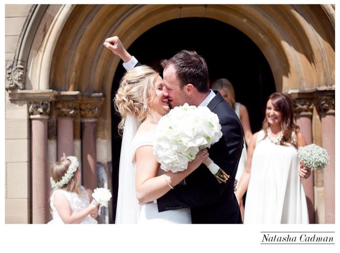 Vintage bus.White wedding. Burlap. Clifton Church. East Keswick. White hydrangeas. Fist pump after ceremony